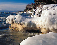 Winter morning light on snow-covered shoreline of Lake Michigan at Cave Point County Park; Door County, WI