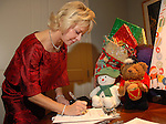 Karen Mayell makes a donation at the M.D. Anderson benefit held honoring the Fourticqs Thursday Dec. 13,2006.(Dave Rossman/For the Chronicle)<br />