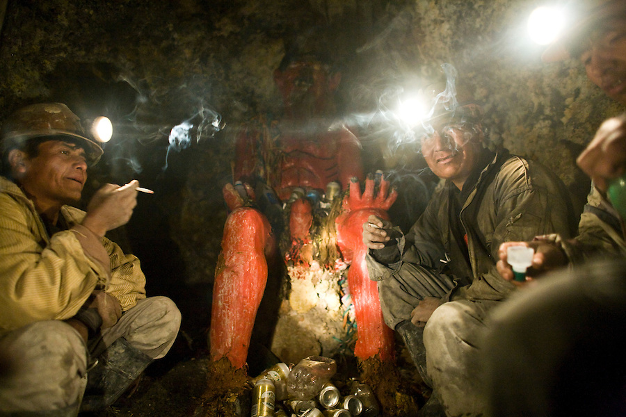 Miners drinking and smoking with the Tío of La Negra mine.