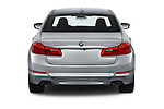 Straight rear view of a 2019 BMW 5 Series 540i Sport Line 4 Door Sedan stock images