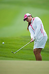 CHON BURI, THAILAND - FEBRUARY 17:  Moriya Jutanugarn of Thailand chips into the 11th green during day two of the LPGA Thailand at Siam Country Club on February 17, 2012 in Chon Buri, Thailand.  Photo by Victor Fraile / The Power of Sport Images