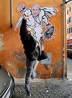 """L'artista di strada Maupal (Maurizio Pallotta) salta di fronte al disegno di Papa Francesco raffigurato come Superman, da lui realizzato ed affisso sulla parete di un palazzo del rione Borgo, nei pressi della Citta' del Vaticano, a Roma, 29 gennaio 2014.<br /> Italian street artist Maupal (Maurizio Pallotta) jumps in fron of his street art mural depicting Pope Francis as Superman, and holding a bag reading """"Values"""" on a wall of the Borgo district near the Vatican, in Rome, 29 January 2014.<br /> UPDATE IMAGES PRESS/Riccardo De Luca<br /> <br /> STRICTLY ONLY FOR EDITORIAL USE"""