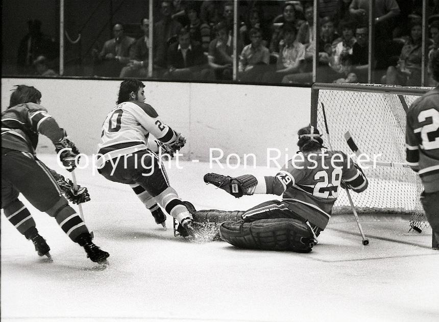 Seals Ernie Hicke scores against the Canadiens Ken Dryden.  (1971 photo/Ron Riesterer