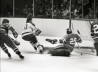 Seals Ernie Hicke scores against the Canadiens Ken Dryden.  (1971 photo/Ron Riesterer