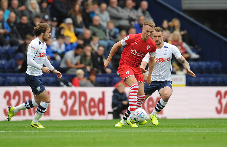 Barnsley's Cauley Woodrow under pressure from Preston North End's Patrick Bauer and Ben Pearson<br /> <br /> Photographer Kevin Barnes/CameraSport<br /> <br /> The EFL Sky Bet Championship - Preston North End v Barnsley - Saturday 5th October 2019 - Deepdale Stadium - Preston<br /> <br /> World Copyright © 2019 CameraSport. All rights reserved. 43 Linden Ave. Countesthorpe. Leicester. England. LE8 5PG - Tel: +44 (0) 116 277 4147 - admin@camerasport.com - www.camerasport.com