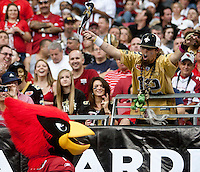 cards1011 166497 10/10/10- Saints fan Dave Souder yells at Big Red during the second quarter of Sunday's home game.  (Pat Shannahan/ The Arizona Republic)