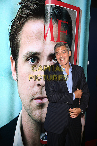 "George Clooney.The New York Premiere of ""The Ides of March"" at the Ziegfeld Theater, New York, NY, USA..October 5th, 2011.half length blue pinstripe suit shirt smiling mouth open.CAP/LNC/TOM.©TOM/LNC/Capital Pictures."