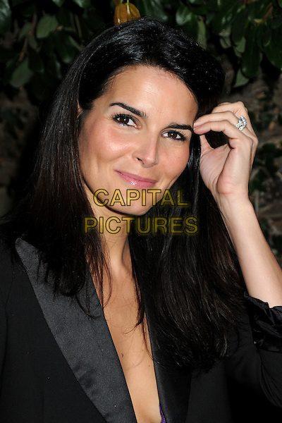 ANGIE HARMON .3rd Annual Women In Film Pre-Oscar Party held at a Private Residence in Beverly Hills, California, USA, .4th March 2010..portrait headshot make-up  black jacket blazer hand on touching hair .CAP/ADM/BP.©Byron Purvis/AdMedia/Capital Pictures.