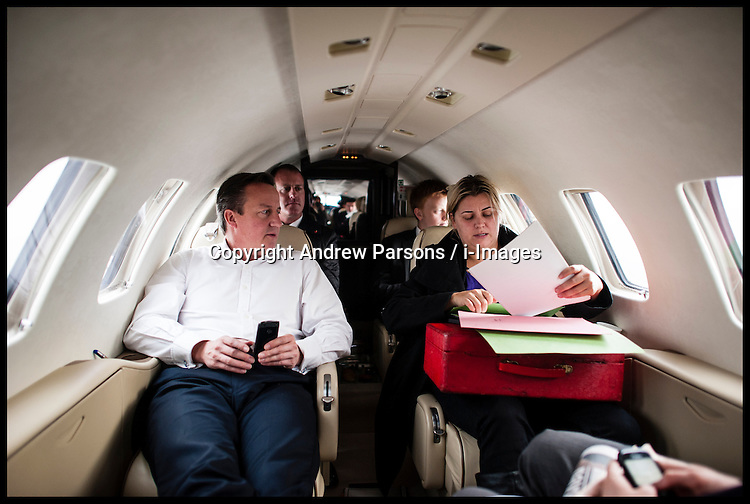 The Prime Minister David Cameron on a plane on route to visit to The Living Well Trust in Carlisle, Cumbria. With PCC Candidate Richard Rhodes, Friday November 9, 2012 Photo Andrew Parsons ..