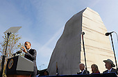 United States President Barack Obama (L) makes remarks at the dedication of the Martin Luther King, Jr Memorial, as (L-R) Vice President Joe Biden, his wife Dr. Jill Biden and Interior Secretary Ken Salazar listen, on the National Mall in Washington DC USA, October 16, 2011.  The ceremony for the slain civil rights leader had been postponed earlier in the summer because of Tropical Storm Irene.     .Credit: Mike Theiler / Pool via CNP