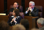 Nevada Attorney General Catherine Cortez-Masto and Assemblymen Michael Sprinkle, D-Sparks, left, and John Hambrick, R-Las Vegas, participate in a press conference at the Legislative Building in Carson City, Nev., on Monday, Feb. 11, 2013..Photo by Cathleen Allison