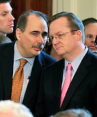 Washington, D.C. - March 23, 2010 -- Presidential Advisor David Axelrod, left, and White House Press Secretary Robert Gibbs, right share some thoughts as United States President Barack Obama signs the version of the health care bill that was passed by the U.S. House of Representatives in the East Room of the White House in Washington, D.C. on Tuesday, March 23, 2010..Credit: Ron Sachs / CNP.(RESTRICTION: NO New York or New Jersey Newspapers or newspapers within a 75 mile radius of New York City)