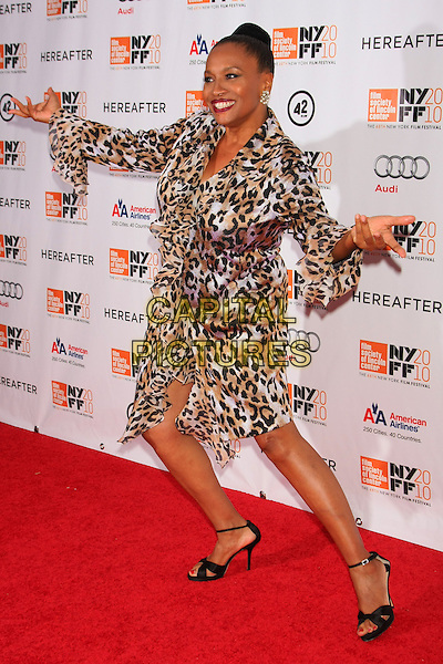 "JENIFER LEWIS .attends the Gala screening of ""Hereafter"" on the Closing Night of the 48th New York Film Festival at Alice Tully Hall, Lincoln Center,  New York, NY, USA, October 10th, 2010..full length arms outstretched leopard print dress ruffle black sandals open toe  animal .CAP/LNC/TOM.©LNC/Capital Pictures."