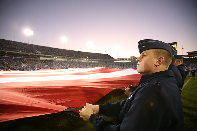 Cadets stretch an American flag across Commonwealth Stadium before the UK vs. Louisiana-Monroe football game for Military Appreciation Day on Saturday, Oct. 24, 2009. Photo by Adam Wolffbrandt | Staff