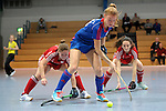GER - Mannheim, Germany, December 19: Antonia Hering #34 of Mannheimer HC in action during the 1. Bundesliga Sued Damen indoor hockey match between Mannheimer HC (blue) and Nuernberger HTC (red) on December 19, 2015 at Irma-Roechling-Halle in Mannheim, Germany. (Photo by Dirk Markgraf / www.265-images.com) *** Local caption *** (L-R) Nina Meller #22 of Nuernberger HTC, Antonia Hering #34 of Mannheimer HC, Salvina Strobel #8 of Nuernberger HTC