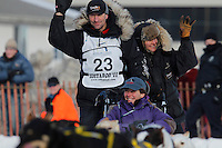 Hans Gatt team makes the turn at Cordova Street and 4th avenue in downtown Anchorage, Alaska during the ceremonial start of the 2011 Iditarod