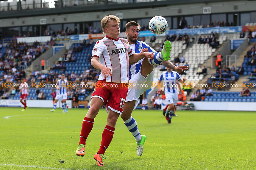 Alex Samuel of Stevenage and Lewis Kinsella of Colchester United during Colchester United vs Stevenage, Sky Bet EFL League 2 Football at the Weston Homes Community Stadium on 12th August 2017