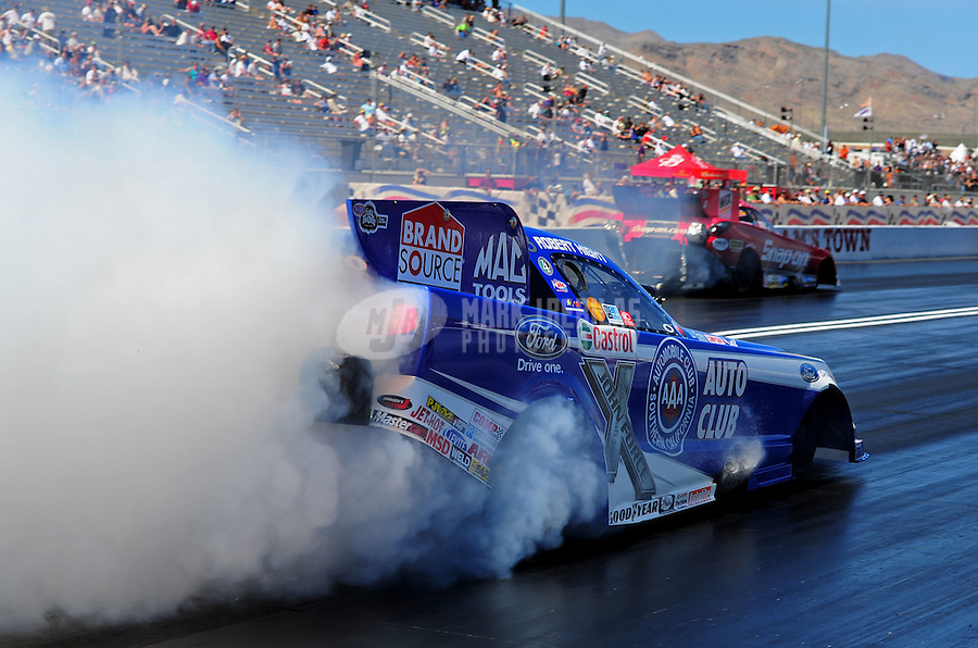 Apr. 1, 2011; Las Vegas, NV, USA: NHRA funny car driver Robert Hight does a burnout during qualifying for the Summitracing.com Nationals at The Strip in Las Vegas. Mandatory Credit: Mark J. Rebilas-