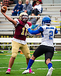 WATERBURY,  CT-101219JS27-  Sacred Heart-Kaynor's Alex Gonzalez (11) gets a pass off while being pressured by Crosby's Zyron Hobbs Elias Diaz-Padilla (2) during their game Saturday at Municipal Stadium in Waterbury.<br /> Jim Shannon Republican-American