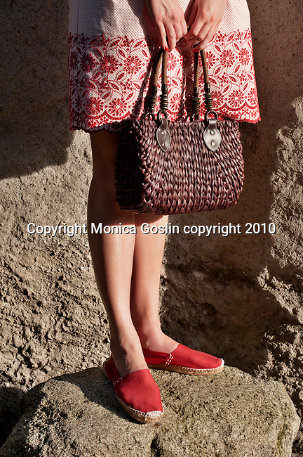 A brown straw purse from Bellagio, Italy with a red and white dress and red espadrilles