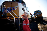 Mechanical shop operator Michael Rocha, directs a locomotive through a Union Pacific repair yard in Roseville, Calif., November 8, 2011. Rocha has worked at Union Pacific for ten years..CREDIT: Max Whittaker/Prime for The Wall Street Journal.HIRE