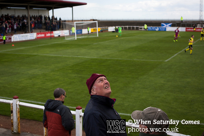 Arbroath 0 Edinburgh City 1, 15/03/2017. Gayfield Park, SPFL League 2. A home supporter keeps an eye on the weather during the first-half mat Gayfield Park as Arbroath hosted Edinburgh City (in yellow) in an SPFL League 2 fixture. The newly-promoted side from the Capital were looking to secure their place in SPFL League 2 after promotion from the Lowland League the previous season. They won the match 1-0 with an injury time goal watched by 775 spectators to keep them 4 points clear of bottom spot with three further games to play. Photo by Colin McPherson.