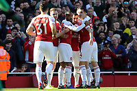 Henrikh Mkhitaryan of Arsenal is congratulated after scoring the second goal during Arsenal vs Southampton, Premier League Football at the Emirates Stadium on 24th February 2019
