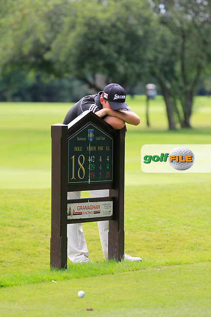 Alan Lowry (Esker Hills) having a rest on the 18th tee during round 2 of the Ulster Youths Amateur Open Championship in Balmoral Golf Club on Wednesday 6th August 2014.<br /> Picture:  Thos Caffrey / www.golffile.ie