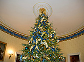 "The 2017 White House Christmas decorations, with the theme ""Time-Honored Traditions,"" which were personally selected by first lady Melania Trump, are previewed for the press in Washington, DC on Monday, November 27, 2017.  This is the top of the White House Christmas tree in the Blue Room.<br /> Credit: Ron Sachs / CNP"