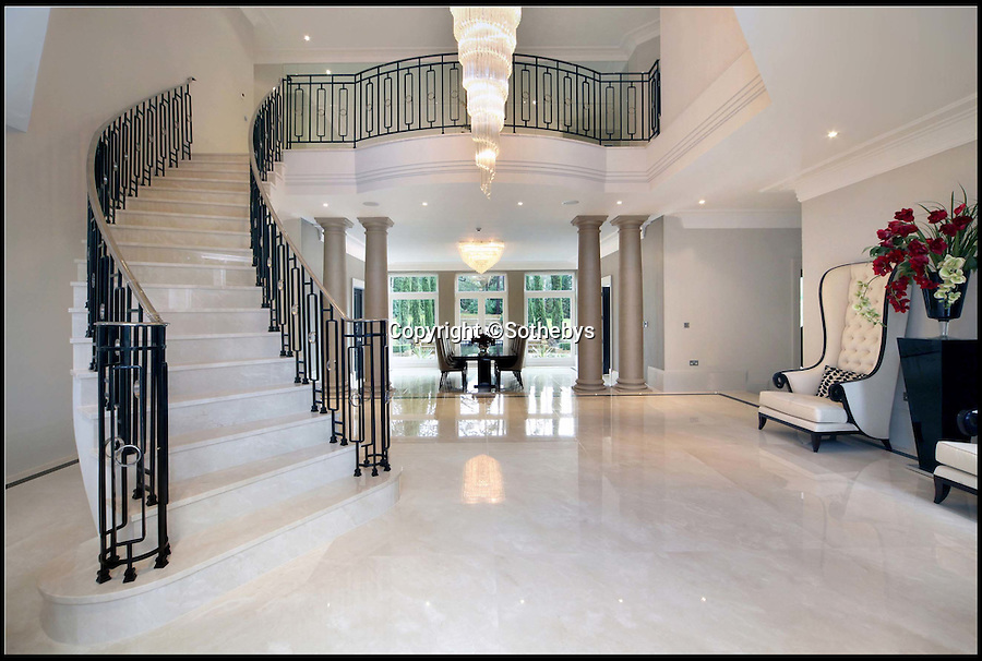 BNPS.co.uk (01202 558833)<br /> Pic: Sothebys/BNPS<br /> <br /> ***Please use full byline***<br /> <br /> Warrenbayne, a Palladian style house on St  George's Hill private estate near Weybridge, Surrey. On the market for a whopping £12.5m. <br /> <br /> To the Manor Reborn...<br /> <br /> Britain's super rich are turning their backs on the decaying stately piles beloved by the aristocracy and building brand new modern mansions on their country estates.<br /> <br /> Rather than investing in the leaky roofs and draughty windows of days gone by, modern millionaires are choosing to build plush pads from the ground up.<br /> <br /> And they are filling their dream homes with every conceivable luxury without the need for a bottomless sink fund to pay for the costly upkeep of older houses.<br /> <br /> Estate agents specialising in top-end properties have reported a clear swing from grand Victorian manor houses to state of the art modern homes kitted out with all the mod cons.<br /> <br /> The multi-million pounds properties have been popping up across the country over the past few years - and are now being heralded as the stately homes of the future.