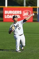 Cody Reed (37) of the Hillsboro Hops throws in the outfield before pitching during a game against the Salem-Keizer Volcanoes at Ron Tonkin Field on July 27, 2015 in Hillsboro, Oregon. Hillsboro defeated Salem-Keizer, 9-2. (Larry Goren/Four Seam Images)