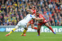 Mathieu Bastareaud of RC Toulon is tackled by Aurelien Rougerie of ASM Clermont Auvergne during the Heineken Cup Final between ASM Clermont Auvergne and RC Toulon at the Aviva Stadium, Dublin on Saturday 18th May 2013 (Photo by Rob Munro)
