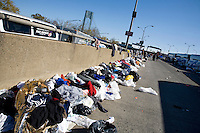 Discarded clothing and other trash litters the on-ramp to the Verrazano-Narrows Bridge after the start of the ING New York City Marathon on Staten Island on 07 November 2010.