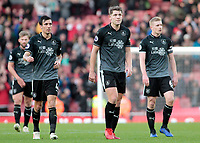 Burnley's James Tarkowski (center), Jack Cork (left) and Ben Mee show their dejection at the final whistle<br /> <br /> Photographer David Shipman/CameraSport<br /> <br /> The Premier League - Arsenal v Burnley - Saturday 22nd December 2018 - The Emirates - London<br /> <br /> World Copyright © 2018 CameraSport. All rights reserved. 43 Linden Ave. Countesthorpe. Leicester. England. LE8 5PG - Tel: +44 (0) 116 277 4147 - admin@camerasport.com - www.camerasport.com