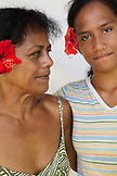 FRENCH POLYNESIA, Moorea. Portrait of woman and her daughter with flower at the Te Nunoa Private Garden Bungalow.
