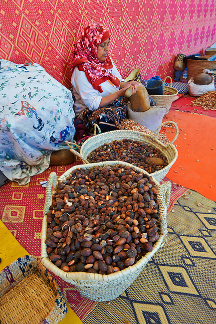 Women cracking Argan nuts at the Cooperative Marjana, Ounara, Essouira, Morocco
