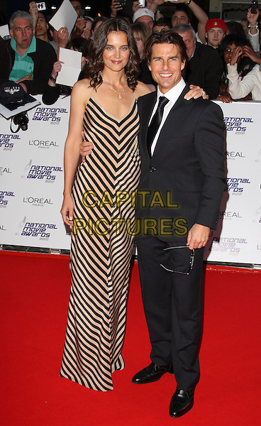 KATIE HOLMES & TOM CRUISE .National Movie Awards 2010 at the Royal Festival Hall, London, England,  May 26th 2010..arrivals  full length long maxi dress cream striped silk arm around white shirt couple married husband wife smiling  suit black tie .CAP/ROS.©Steve Ross/Capital Pictures.