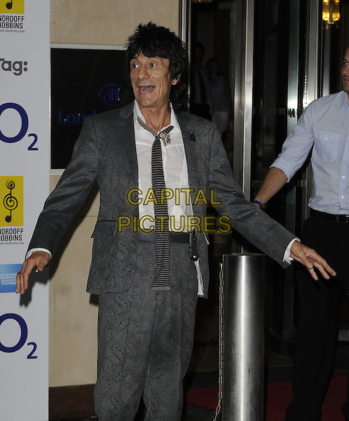RONNIE WOOD .At the O2 Silver Clef Awards, Hilton Park Lane hotel, London, England, UK, July 2nd 2010..half length grey gray suit tie shirt print patterned pattern paisley hands mouth open funny .CAP/CAN.©Can Nguyen/Capital Pictures.