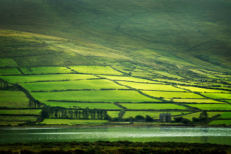 Green fields on the Ring of Kerry as seen from Valentia Island, Ireland
