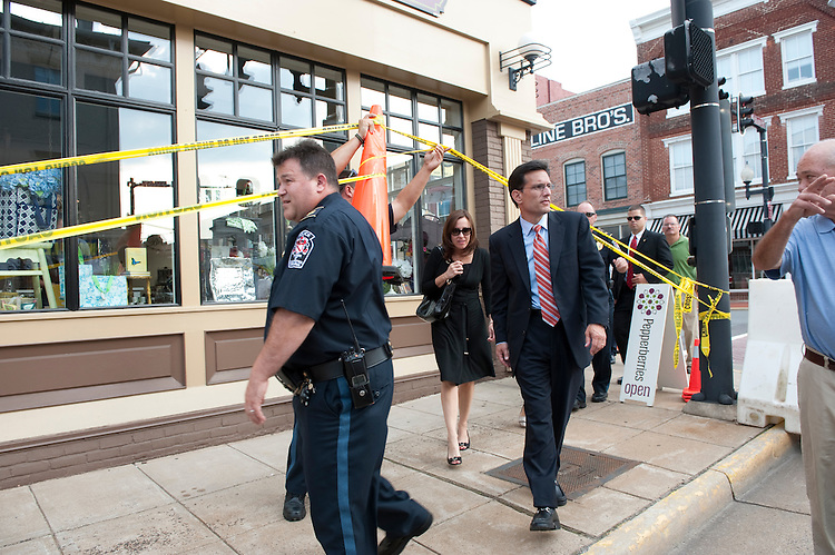 UNITED STATES - August 24 : Eric Cantor, R-VA., checks damage in downtown Culpeper Virginia along with town officials. The damage from the earthquake was substantial with lots of streets and businesses are closed. (Photo By Douglas Graham/Roll Call)