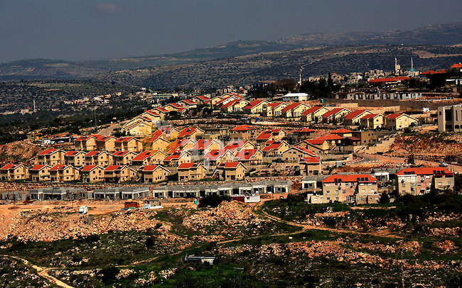 "Israeli jewish settlement of Kiryat Netafim is seen near the West Bank village of Salfit, Monday, March 14, 2011. The U.S. Embassy said Monday it was ""deeply concerned"" by Israel's plans to build hundreds of new homes in the West Bank following the deadly attack that killed five family members, calling Israeli settlements ""illegitimate"" and an obstacle to peacemaking. Photo by Wagdi Eshtayah"