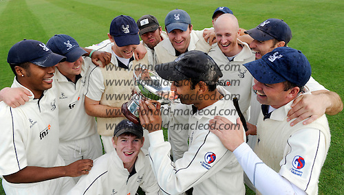 Scottish National Cricket League, Premier Div - Forfarshire V Grange at Forthill, Dundee - that champagne moment for Grange Capt Sanjay Patel as team-mates Stuart Davidson (left) and Michael Powell celebrate their 2010 league victory in a traditional manner. Grange chased down the Forfs paltry 90 total in 11.2 overs - Picture by Donald MacLeod - mobile 07702 319 738 - clanmacleod@btinternet.com - words if required from William Dick 077707 839 23