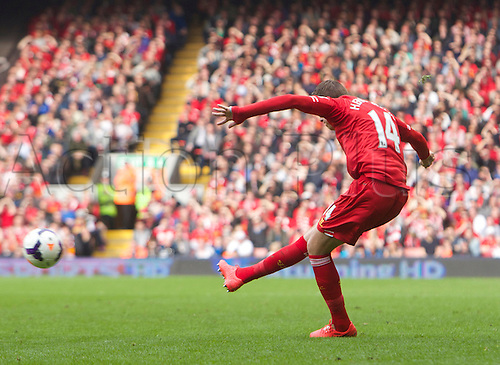 30.03.2014  Liverpool, England.   Liverpool's Jordan Henderson  scoring a free-kick to make it 4-0 during the Premier League game between Liverpool and Tottenham Hotspur from Anfield