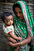 A woman and her child poses for a photo during the women's SHG (self help group) meeting in Barji Village, in Muzaffarpur, Bihar. Photograph: Sanjit Das/Panos for Legatum Foundation