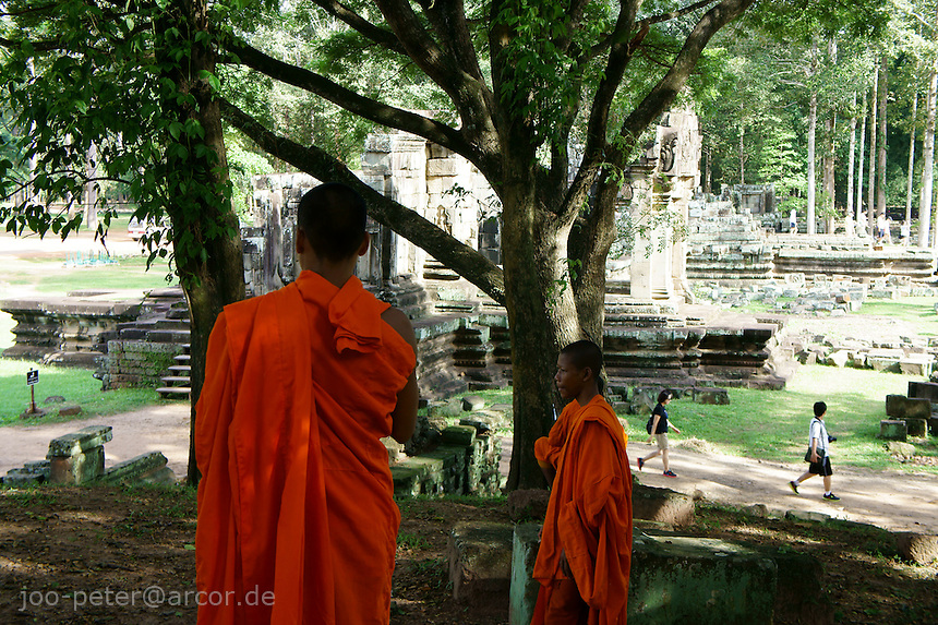 Buddhist monks close to Baphuon temple,  Angkor Wat, Cambodia, August 2011