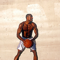 Basketball player poised to pass the ball
