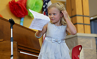 NWA Democrat-Gazette/DAVID GOTTSCHALK  Cydney Lipinski, a first grade student at Butterfield Elementary School, collects Thursday, May 25, 2017, her music after playing Jingle Bells on the piano during the Butterfield's Got Talent Variety Show at the school in Fayetteville. Kindergarten through second grade performed in the show that featured puppets, dance and musical instrument performances.