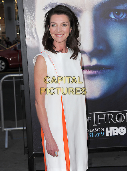 "Michelle Fairley.""Game Of Thrones"" 3rd Season Los Angeles Premiere held at the TCL Chinese Theatre, Hollywood, California, USA..March 18th, 2013.half length dress orange white sleeveless  .CAP/RKE/DVS.©DVS/RockinExposures/Capital Pictures."