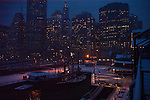 Ships moored in the marina and office lights. Images of New York 2005, New York,U.S.A