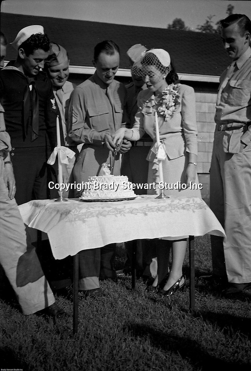 Valley Cottage NY - Brady and Marjorie Stewart cutting their wedding cake - June 1944.  Brady and Marjorie were married near New York City where Brady was stationed during the war.  The reception was at Marjorie's home in Valley Cottage, New York.  The parents, Jack and Catherine Zapp and Brady and Sarah Stewart were in attendance.